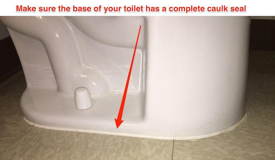 toilet base with caulk seal